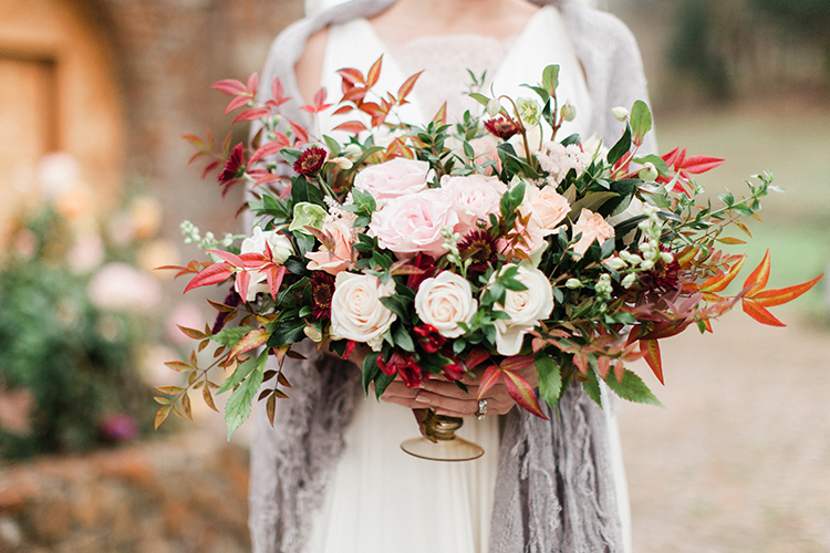 fall wedding centerpieces - http://ruffledblog.com/winery-vow-renewal-inspiration-with-autumn-leaves