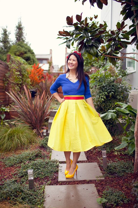 Snow White costume with a red midi skirt, a blue sweater with a matching shirt, bold yellow heels and a headband