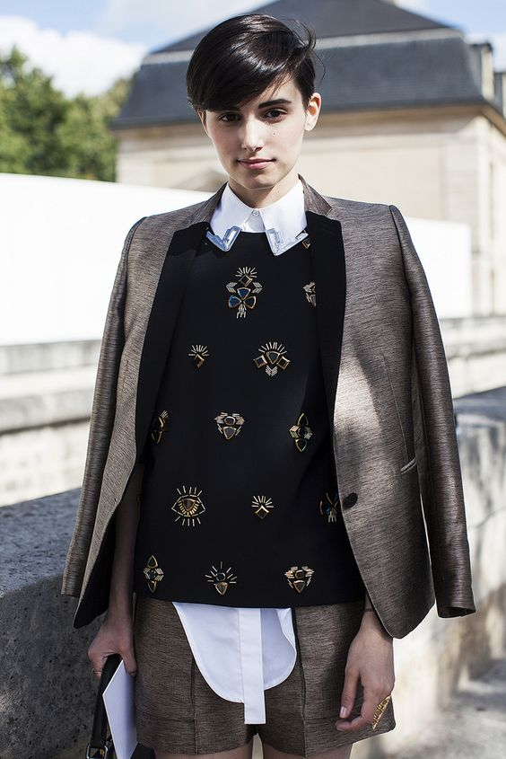 a brown shorts suit, a white shirt, a black embellished sweater for a creative work look