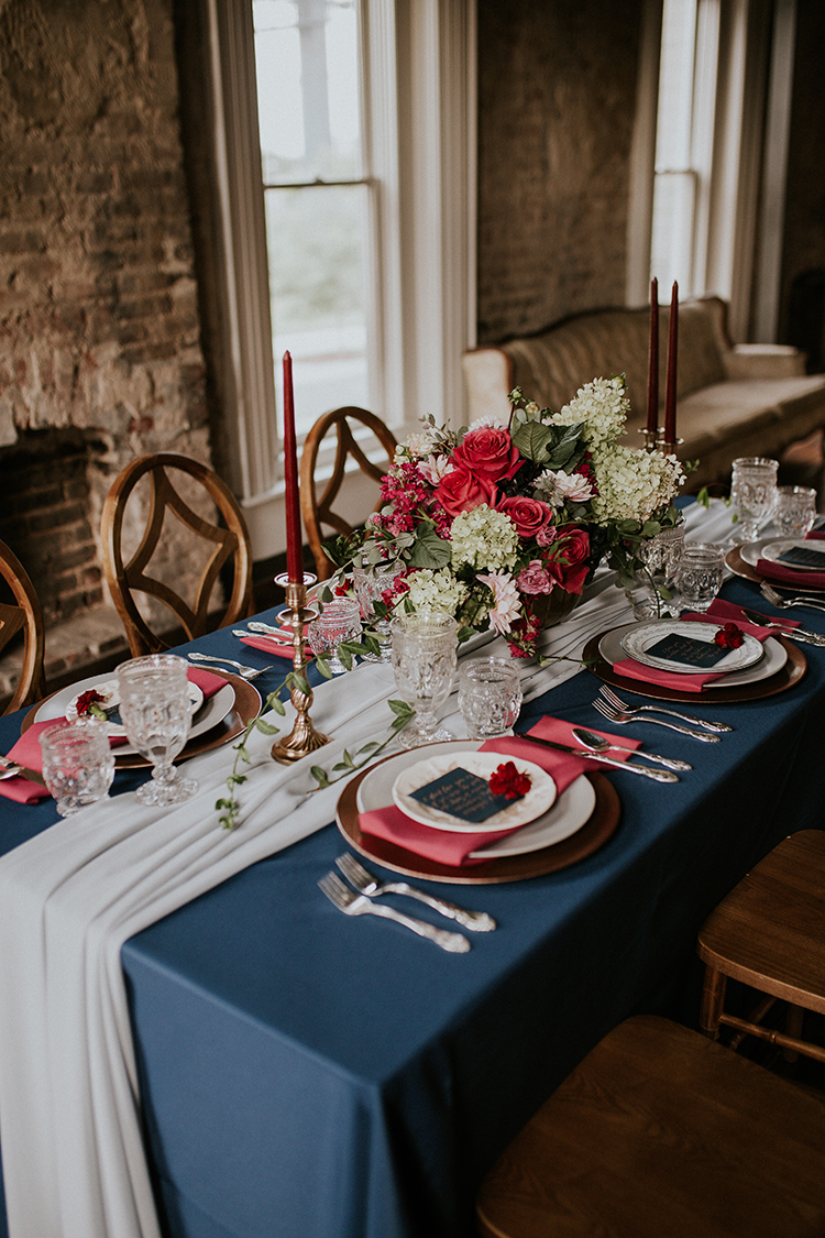 blue and red wedding tables - http://ruffledblog.com/artist-inspired-wedding-ideas-with-oxblood-and-navy