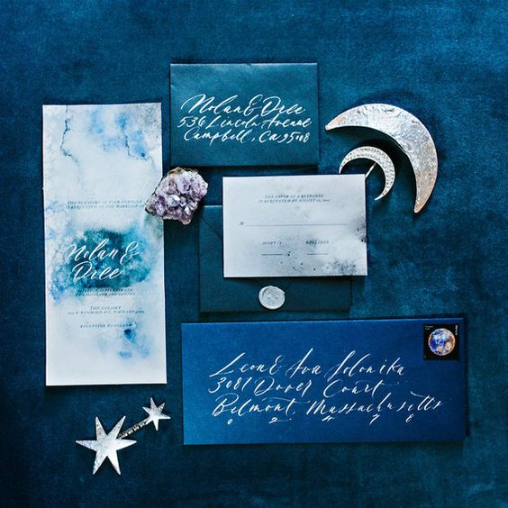 starry night themed wedding stationery with watercolor teal and grey invites and blue and teal envelopes