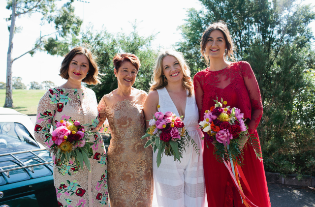 The bridesmaids were wearign mismatched dresses, a white striped one and a floral one