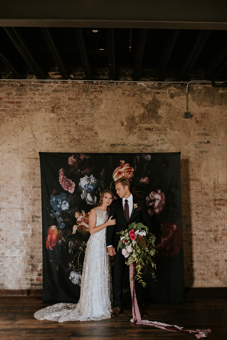 floral wallpaper backdrops - http://ruffledblog.com/artist-inspired-wedding-ideas-with-oxblood-and-navy