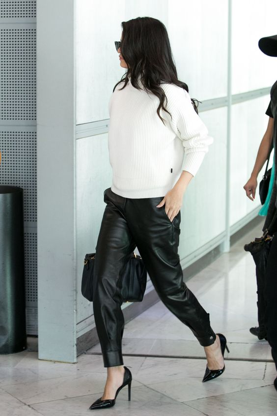 black leather pants, black heels and a white cropped sweater are things with which you can't go wrong