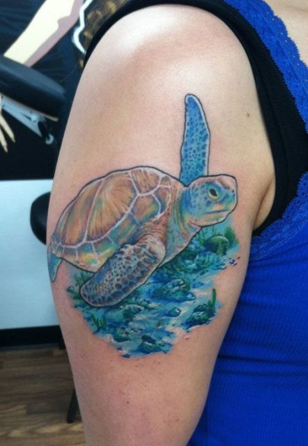 Turtle and sea tattoo on the arm