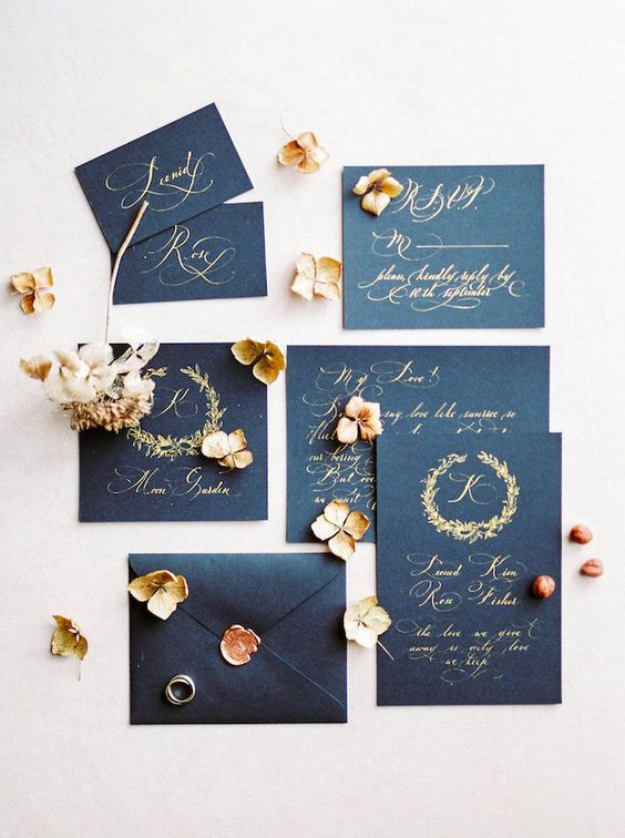 black and gold wedding invites with seals look very elegant and timeless