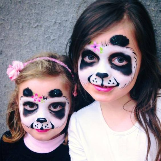panda-inspired face paint for both girls looks cute and chic