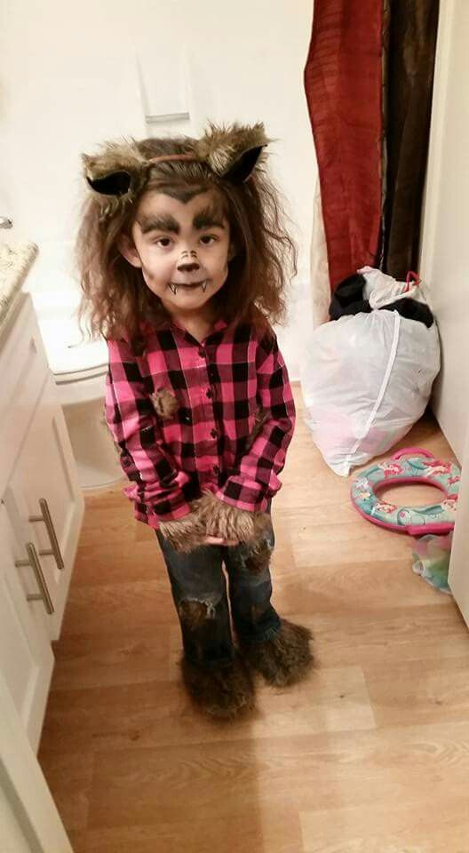 girly werewolf costume and makeup with ears and faux fur decorated clothes