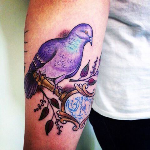 Purple dove tattoo on the hand