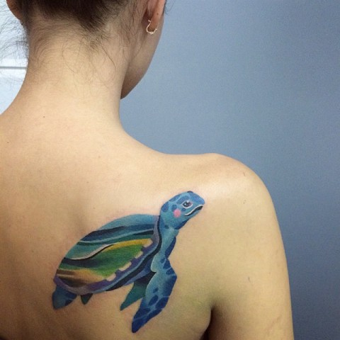 Blue, yellow and green turtle tattoo