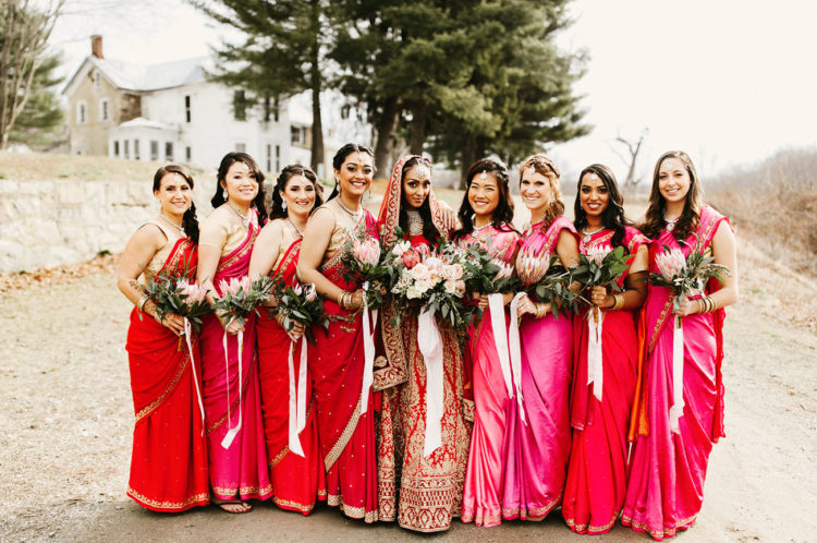 The bridal party tried the exotic and bold Indian clothes in red and fuchsia