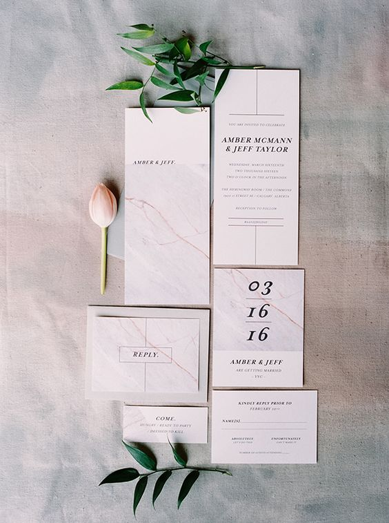 laconic marble wedding invites with black letters and numbers for a simple modern wedding