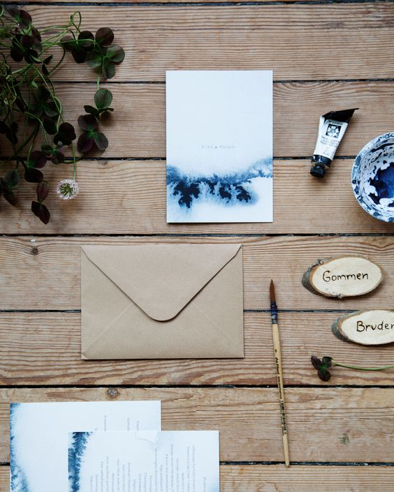 watercolor navy blue wedding invites and craft paper envelopes will fit many different wedding themes