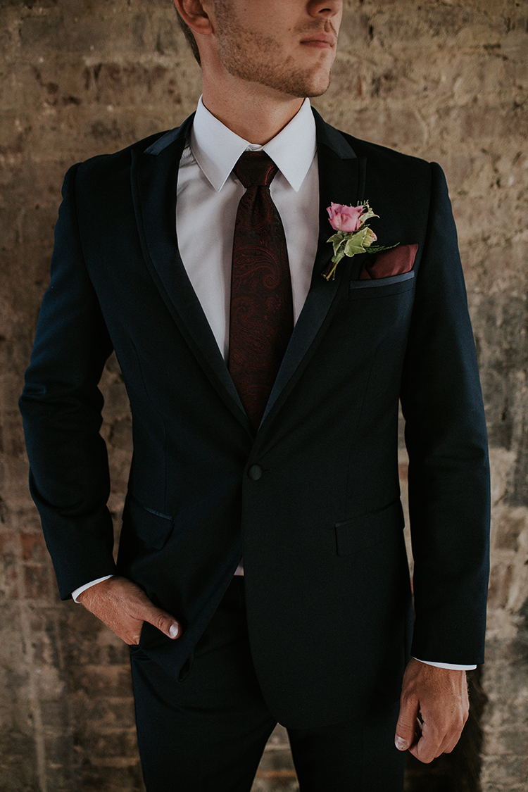 chic groom suits - http://ruffledblog.com/artist-inspired-wedding-ideas-with-oxblood-and-navy