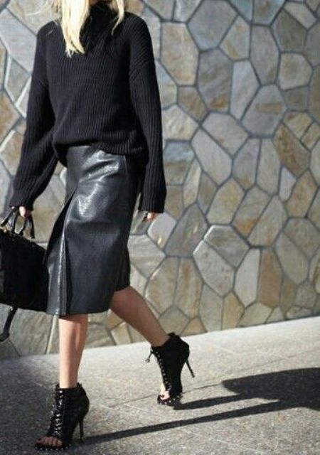 an all-black fall look with a black leather midi skirt, peep toe black leather booties and a black chunky knit sweater