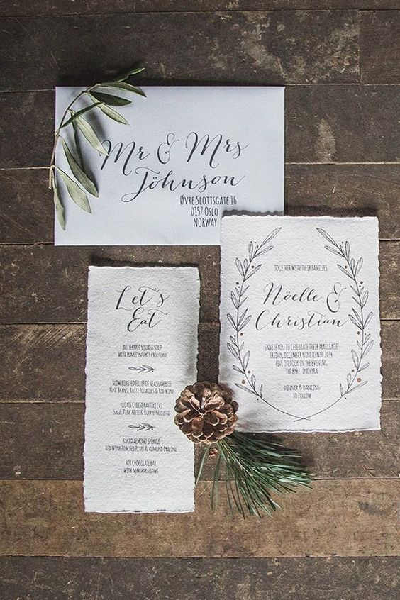 contemporary winter wedding invitations in neutrals, with black calligraphy and a raw edge