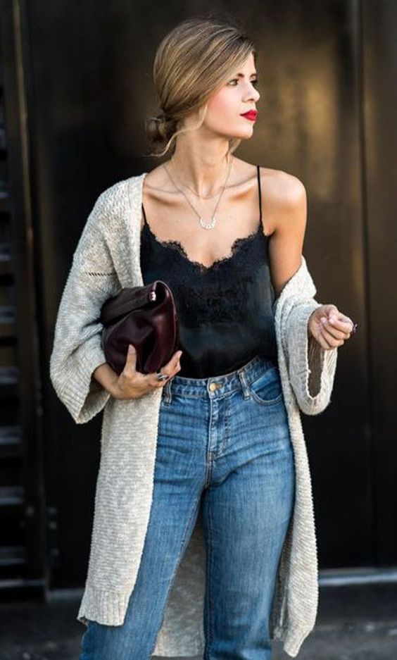 blue jeans, a black lace top, a grey cardigan and a burgundy clutch