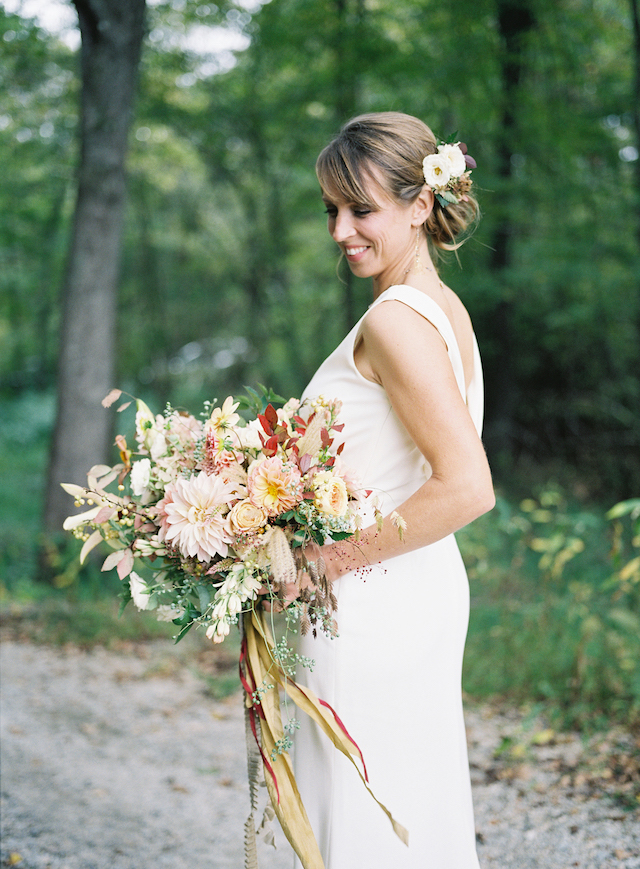 This wedding took place in a barn, which was built especially for the wedding, and it featured spectacular flowers