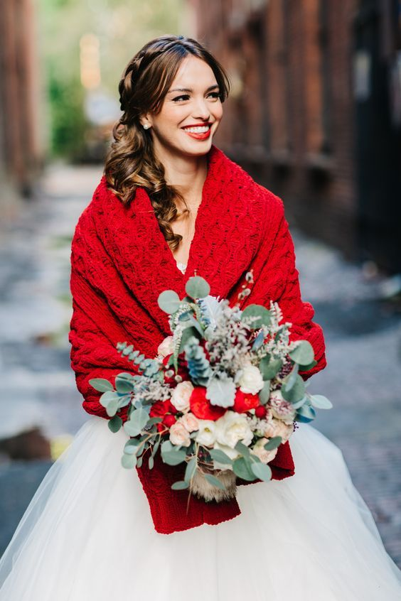 a red knit coverup and a red lip makes this bridal look bold and very eye-catchy