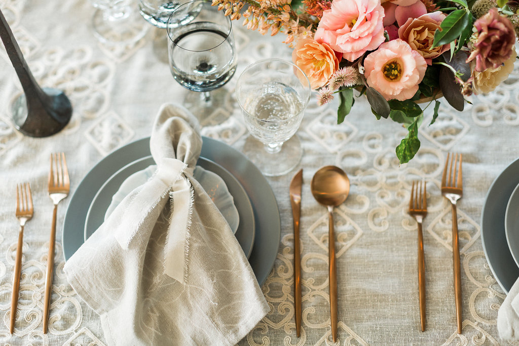 romantic wedding linens for tablescapes - https://ruffledblog.com/cloudy-day-wedding-inspiration-with-a-hand-painted-bridal-gown