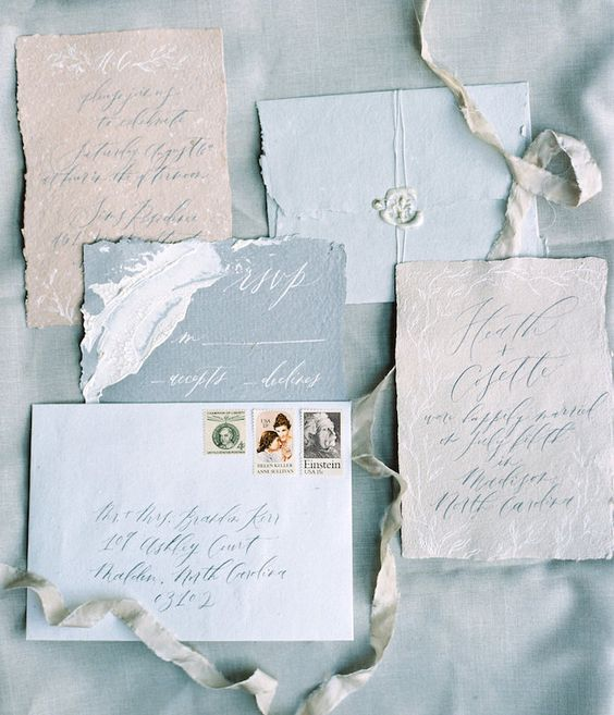 pastel blue wedding stationery suite with a raw edge, calligraphy and seals