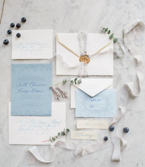 neutral and blue wedding stationery with ethereal ribbons, a raw edge and seals