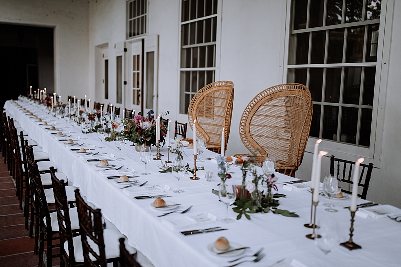 rattan chairs for the wedding sweetheart table - http://ruffledblog.com/laid-back-los-poblanos-wedding-with-orange-bridesmaid-gowns