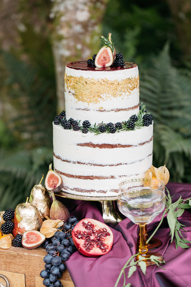 wedding cakes with gold details and berries - https://ruffledblog.com/woodland-luxe-wedding-inspiration-with-fall-colors