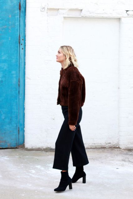 With black culottes and ankle boots