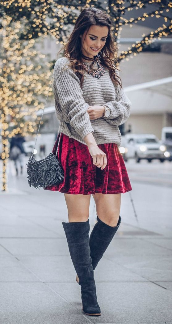 pair a red velvet mini skirt with an oversized neutral sweater and suede boots