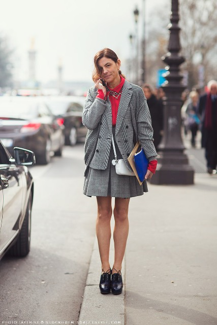 With red blouse, mini skirt, platform shoes and white bag