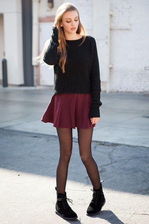 a black slouchy sweater, a burgundy skater skirt, black tights and black suede boots