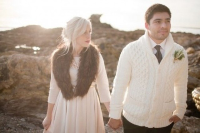 the groom wearing a white cable knit cardigan instead of a jacket