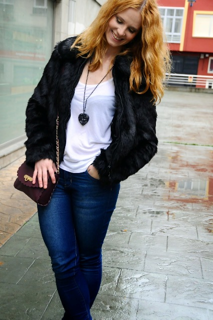 With white top, jeans and marsala bag