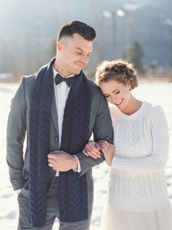 the bride rocking a white cable knit sweater and the groom with a matching navy scarf