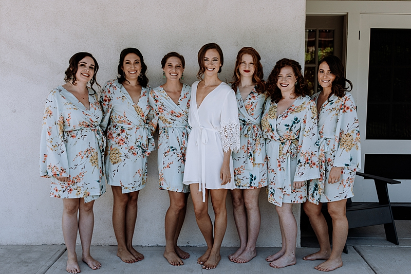bridesmaids in floral robes - http://ruffledblog.com/laid-back-los-poblanos-wedding-with-orange-bridesmaid-gowns