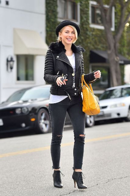 With white t-shirt, leather jacket, distressed jeans, ankle boots and orange bag