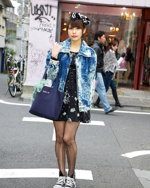 With printed dress, sneakers and blue bag
