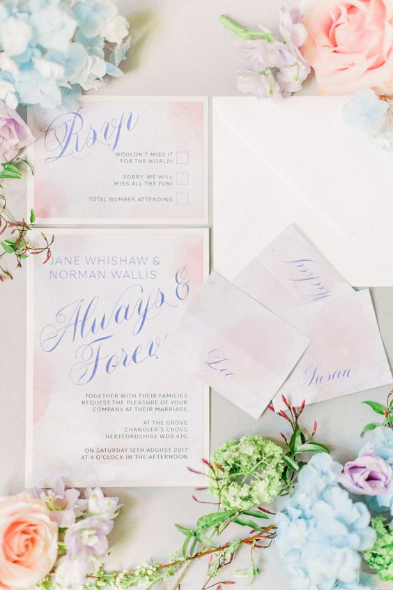 watercolor blush wedding stationery with blue calligraphy is a chic spring or summer idea