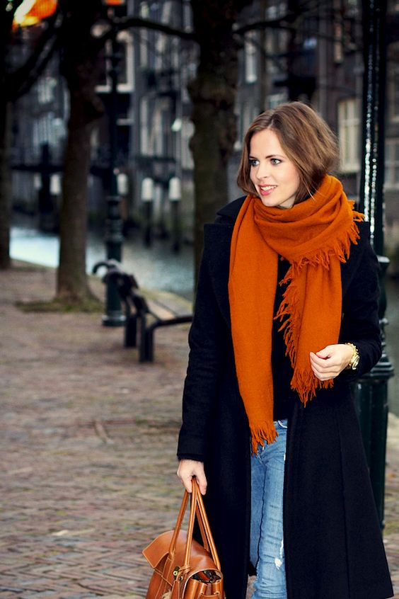 a chic and warm burnt orange scarf and a matching bag to spruce up a basic outfit
