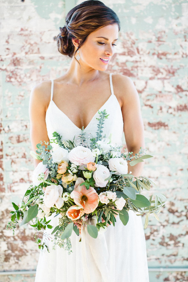 Peach, white, and green bridal bouquet