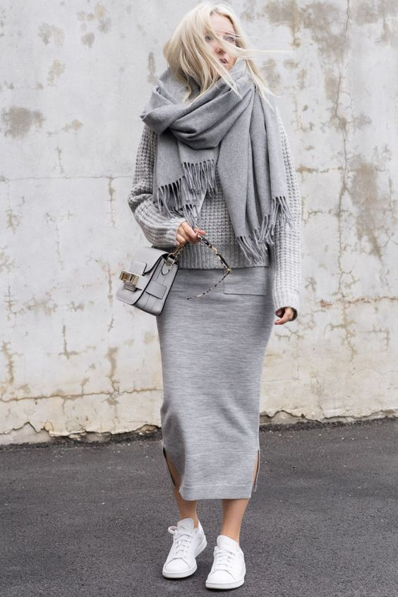 a grey sporty midi skirt, a grey sweater, a grey wrap scarf and white sneakers
