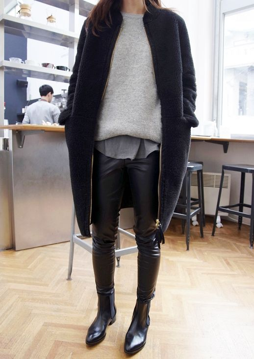 black leather leggings, black chelsea boots, a grey tee, s grey sweater and a navy coat