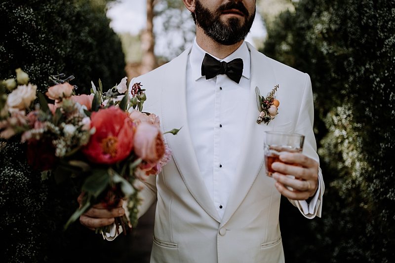 grooms in white tuxedos - http://ruffledblog.com/laid-back-los-poblanos-wedding-with-orange-bridesmaid-gowns