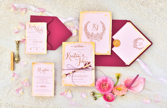 Pink, gold, and red wedding invitations