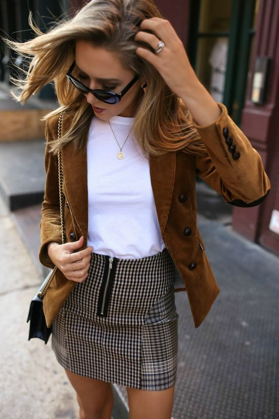 a checked mini skirt, a white tee, an ocher velvetine jacket