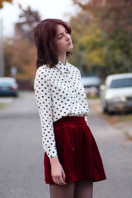 a red velvet midi skirt, a heart print shirt in black and white for a sexy look