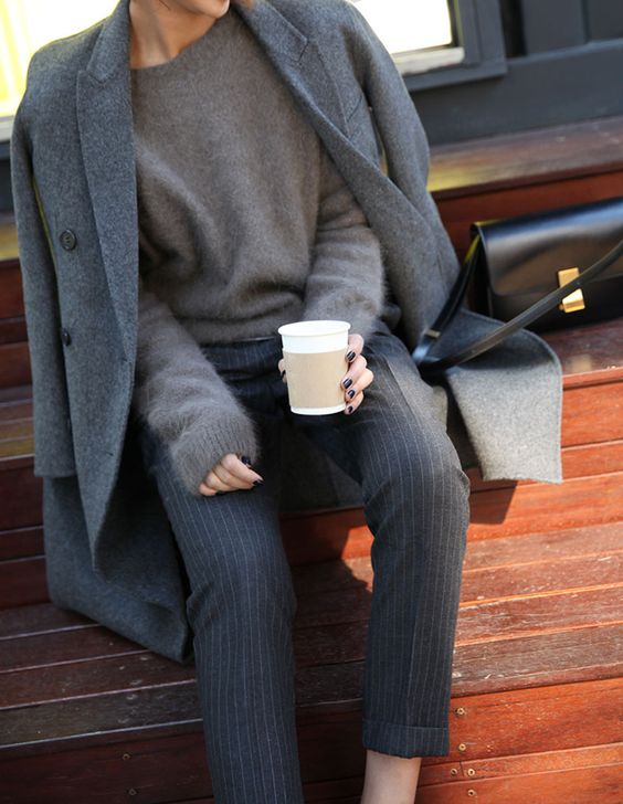striped grey pants, a grey angora sweater and a grey wood coat are an ideal example of fall layering