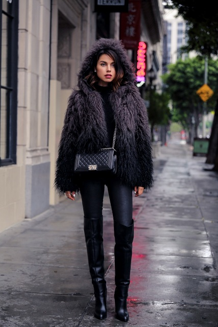 With black turtleneck, leather skinny pants, high boots and crossbody bag