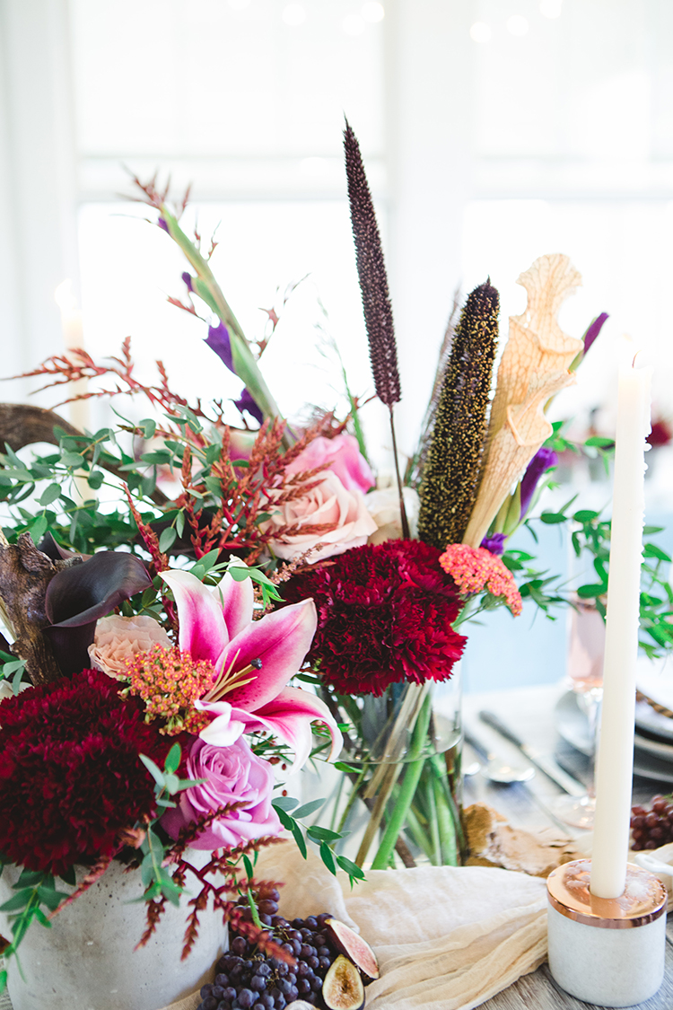 tropical inspired wedding flowers - http://ruffledblog.com/fall-wedding-tablescape-with-an-unexpected-color-palette